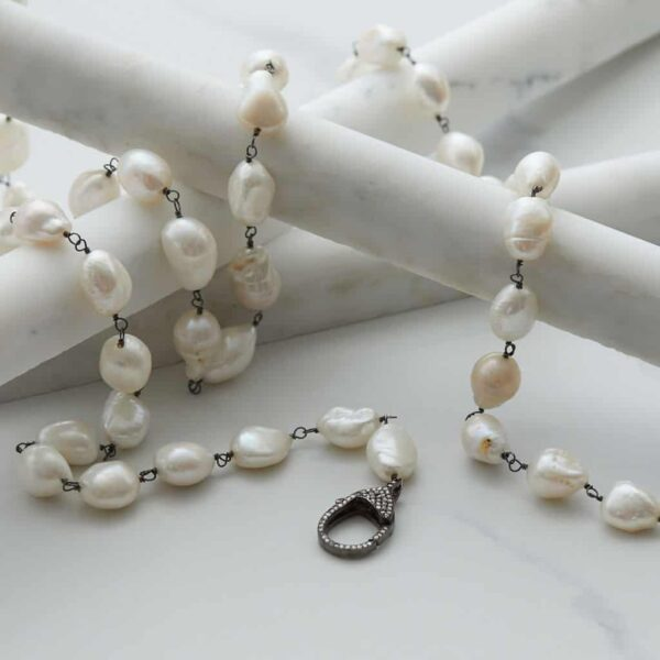 This white baroque pearl necklace with a pave diamond clasp is a must add to your pearl jewelry. This pearl rope necklace- a perfect June birthstone jewelry gift.