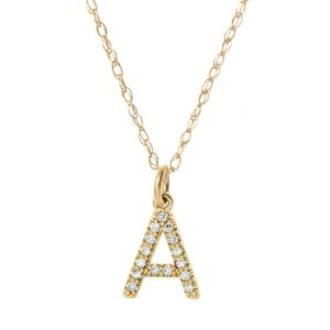 Single diamond pave initial necklace in yellow gold. This custom initial necklace is a favorite pieces of custom jewelry. The perfect custom gift.