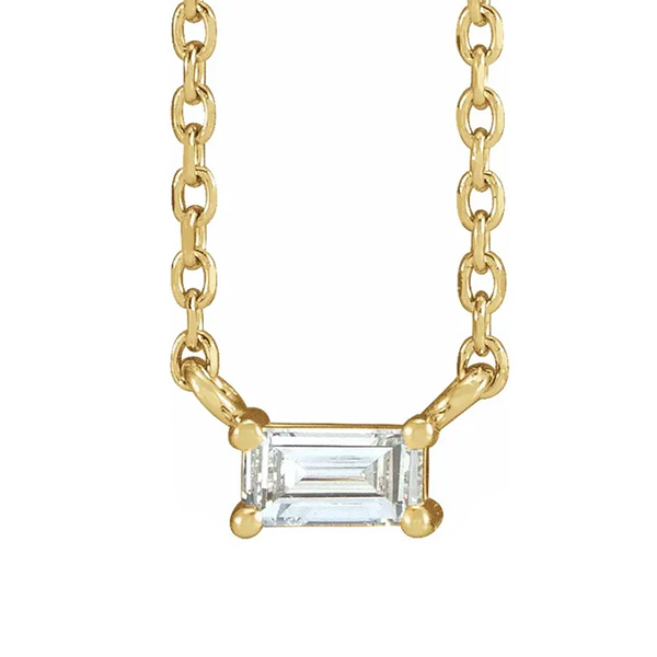 Diamond baguette necklace in yellow gold is a favorite piece of diamond jewelry - a perfect April birthstone jewelry gift.