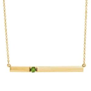 The peridot bar necklace in yellow gold is a favorite piece of peridot jewelry - a perfect August birthstone jewelry gift.
