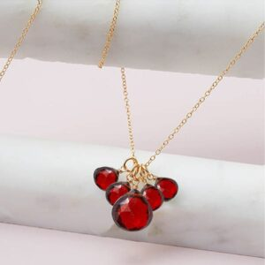This garnet elsa 5 stone pendant necklace in gold is a favorite piece of garnet jewelry - a perfect piece of january birthstone jewelry.