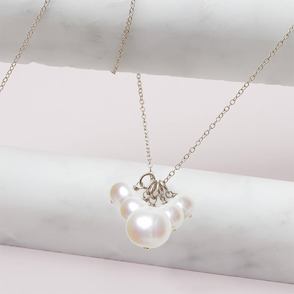 This Elsa 5 pearl necklace in silver is a favorite piece of pearl jewelry - a perfect June birthstone jewelry gift.