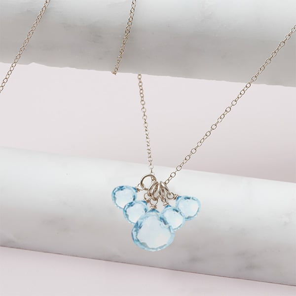 elsa style December birthstone necklace in swiss blue topaz and sterling silver by Erin Gallagher