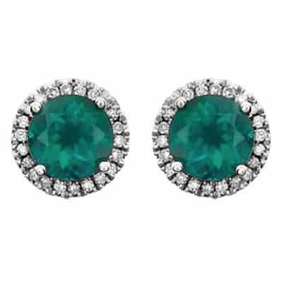 These diamond halo emerald earrings in white gold are a favorite piece of emerald jewelry - a perfect May birthstone jewelry gift.