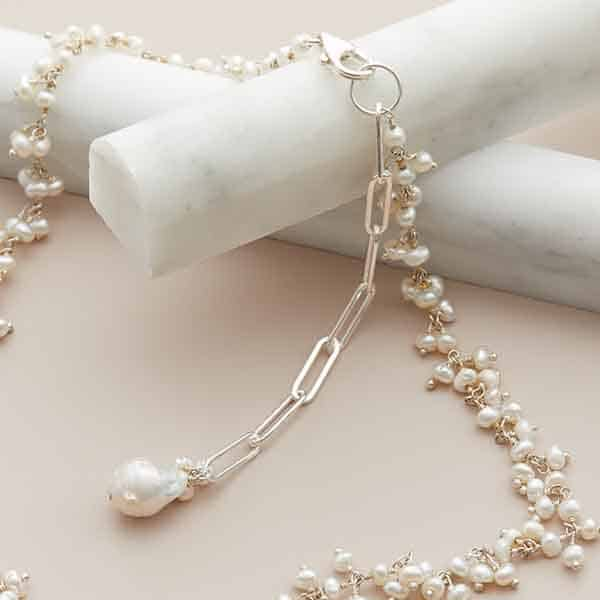 This tiny pearl lariat necklace in silver is a favorite piece of pearl jewelry - a perfect June birthstone jewelry gift.