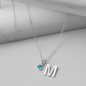 This personalized initial necklace with a birthstone accent in white gold is a favorite personalized initial necklace - the perfect personal initial necklace.