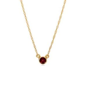 This garnet bezel-set pendant necklace in yellow gold is a favorite piece of garnet jewelry - a perfect piece of january birthstone jewelry.