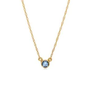 The Jen swiss blue topaz bar necklace in yellow gold is a favorite piece of swiss blue topaz jewelry - a perfect December birthstone jewelry gift