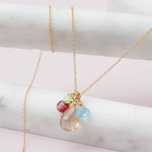 Design your own birthstone necklace. This Jordan 4 stone personalized necklace in gold is a favorite piece of personalized jewelry. This custom birthstone necklace is a perfect birthstone gift.