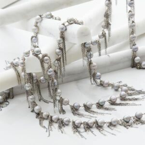 This white fringe baroque pearl necklace in oxidized silver is a favorite piece of pearl jewelry. A pearl necklace - a perfect June birthstone jewelry gift.
