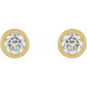 These micro bezel-set diamond earrings in yellow gold are an easy gift. These tiny diamond studs are a favorite among of diamond earrings. The perfect diamond earrings.