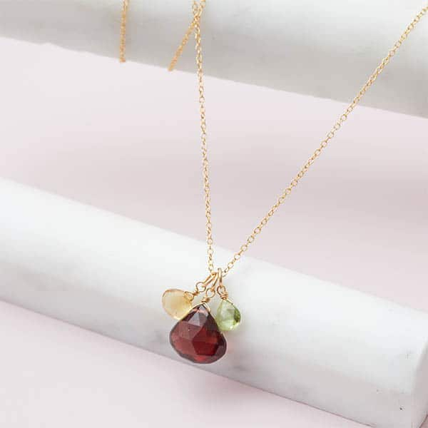 Design your own birthstone necklace. This Nora 3 stone custom necklace in gold is a favorite piece of custom jewelry - a perfect custom birthstone gift.
