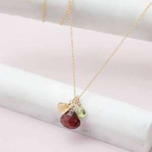 Create your own birthstone necklace. This Nora 3 stone custom necklace in gold is a favorite piece of custom jewelry - a perfect custom birthstone gift.