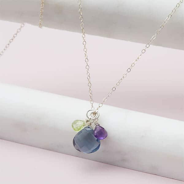 Design your own birthstone necklace. This Nora 3 stone personalized necklace in gold is a favorite piece of personalized jewelry - a perfect personalized birthstone gift.
