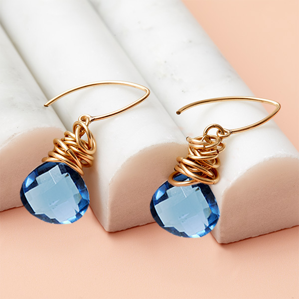 These Paisley london blue topaz earrings in gold are a favorite piece of london blue topaz jewelry - a perfect September birthstone jewelry gift.