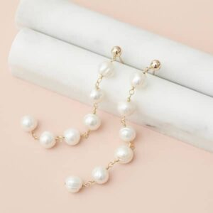 The long pearl earrings in gold are a favorite piece of pearl jewelry - a perfect June birthstone jewelry gift.