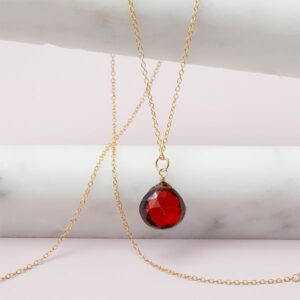 This garnet rita pendant necklace in gold is a favorite piece of garnet jewelry - a perfect piece of january birthstone jewelry.