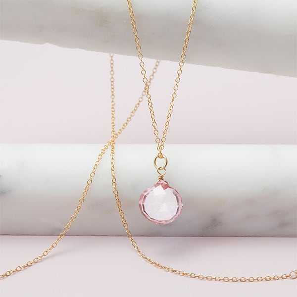 This Rita pink topaz necklace in silver is a favorite piece of pink topaz jewelry - a perfect October birthstone jewelry gift.