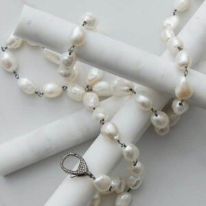 This long white baroque pearl necklace is a must add to your pearl jewelry. This pearl necklace- a perfect June birthstone jewelry gift.