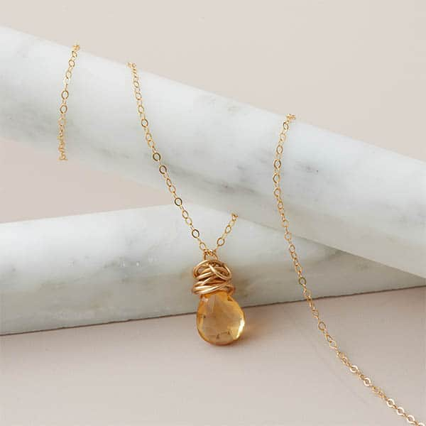 This Trista birthstone necklace in gold is a favorite piece of birthstone jewelry - a perfect custom birthstone jewelry gift.