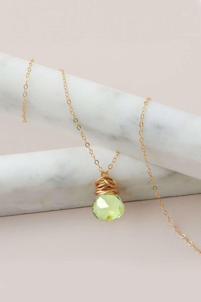 peridot necklace in gold by erin gallagher