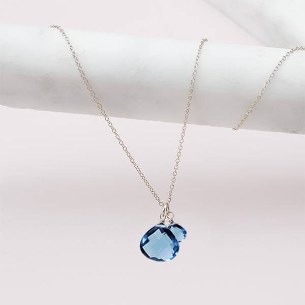 handmade london blue topaz necklace in silver by erin gallagher