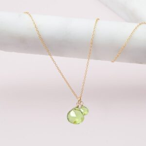 hand-made peridot necklace in gold by erin gallagher