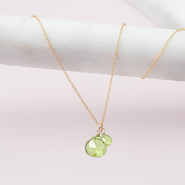 This Violet 2 stone peridot necklace in gold is a favorite piece of peridot jewelry - a perfect August birthstone jewelry gift.